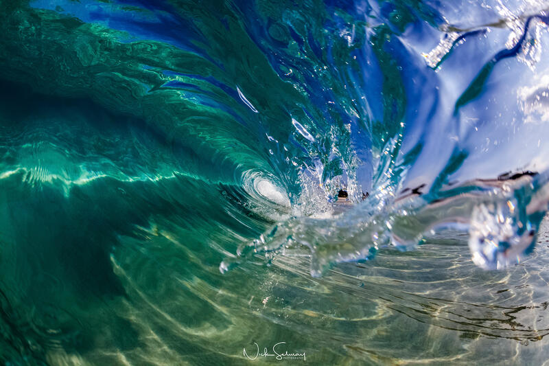 In this gorgeous image, the Hawaiian wave barreling over looks as clear as liquid glass. Shop this print & a variety of wave photography we have for sale.
