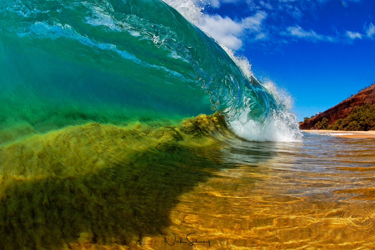 In this print, sand sucks up into the barrel of the wave as it crashes into Makena Beach. Shop this print & a variety of Hawaii photography prints for sale.