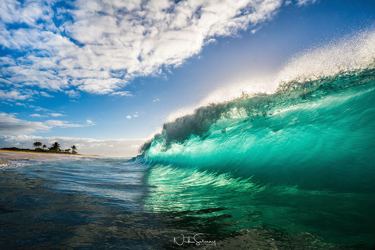 In this stunning wave photo, a large wave swells to then crash into Sandy Beach in Oahu. Shop this print & a variety of crashing waves photography for sale.