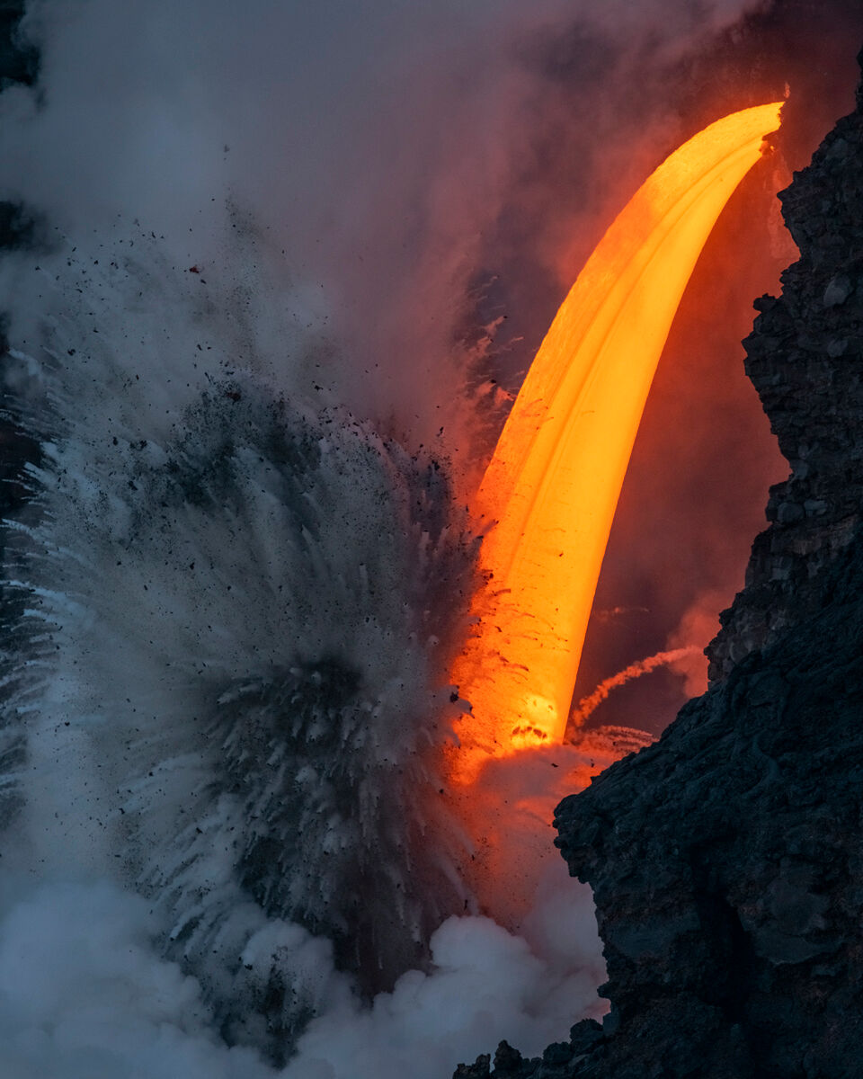 """Just a couple of days after a sea cliff collapsed and cut off a dramatic stream of lava in Hawaii, the so-called """"fire hose..."""