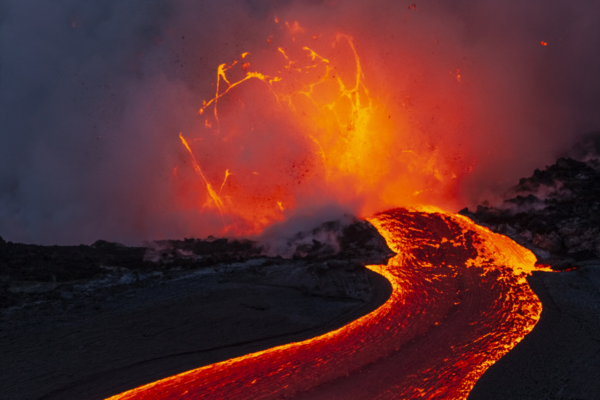 A bubble of lava forms at the end of a river of lava.