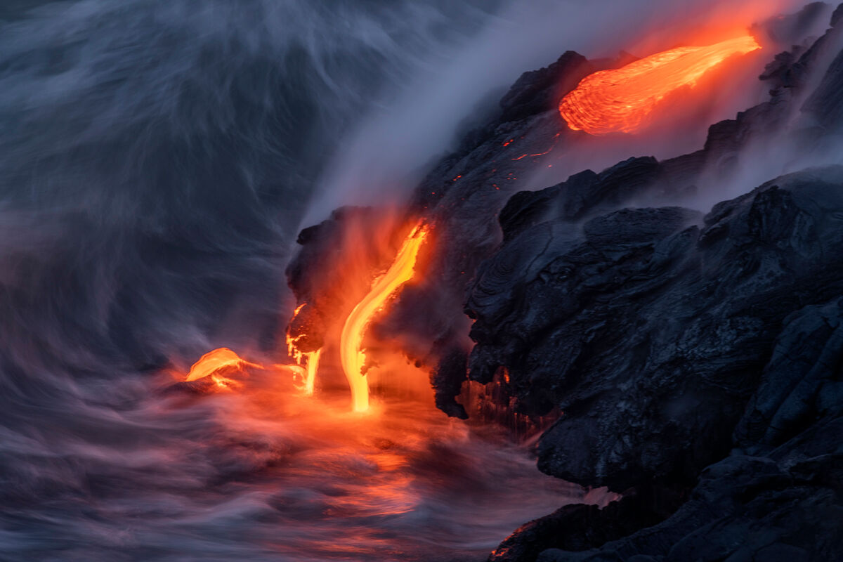 2 Drips of lava meet the sea and the incoming waves cool off the lava.