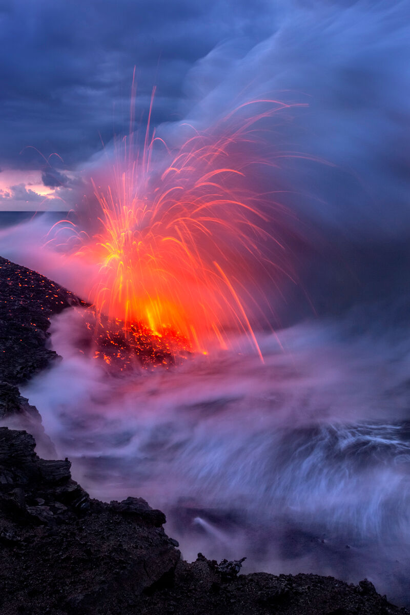 Hiking out to the Kilauea Volcano ocean entry I came upon this scene as the sun came up the lava was exploding 50-100 feet in...