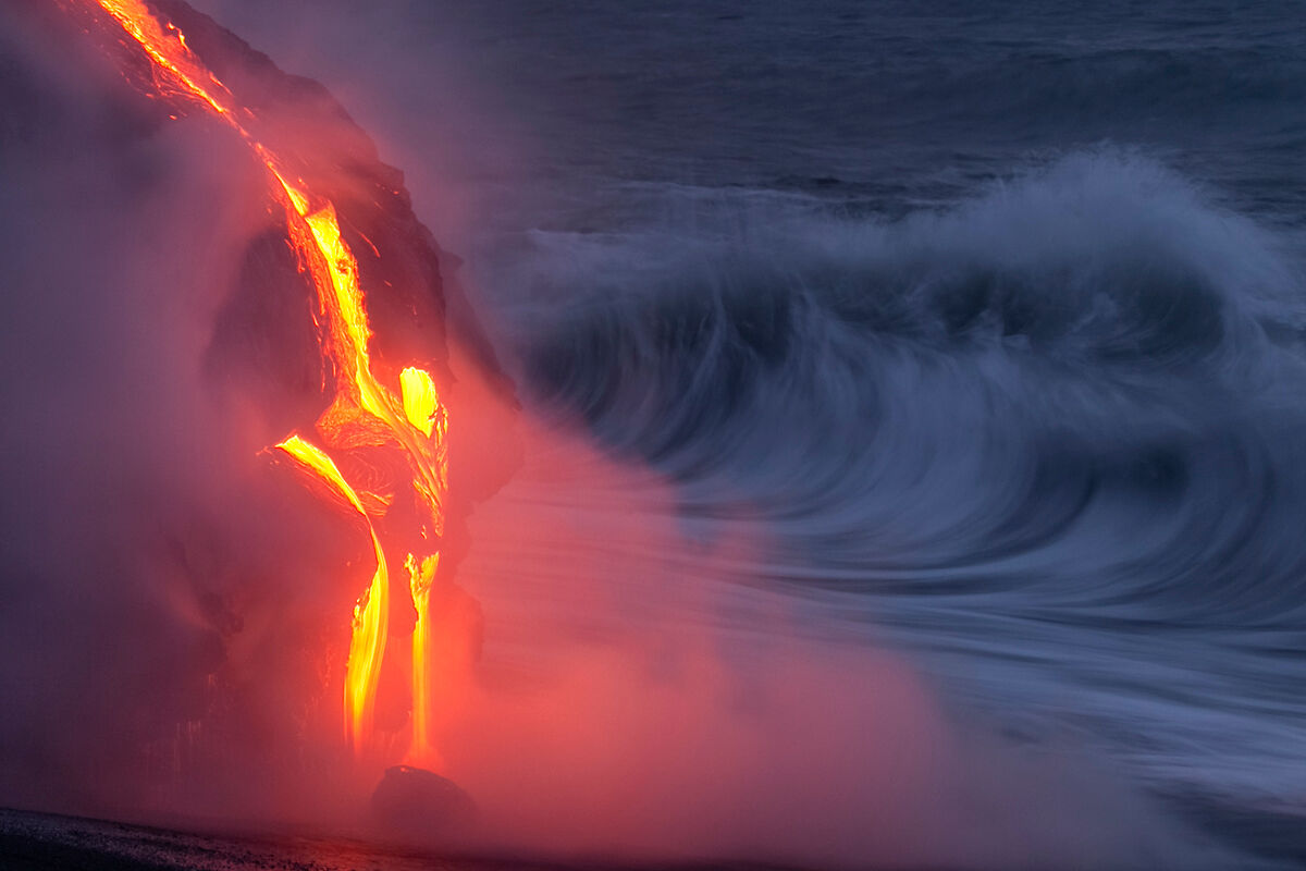 Lava and waves collide at sunrise.
