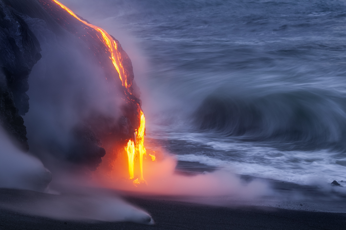 Hot steaming rocks from the lava cover this black sand beach.