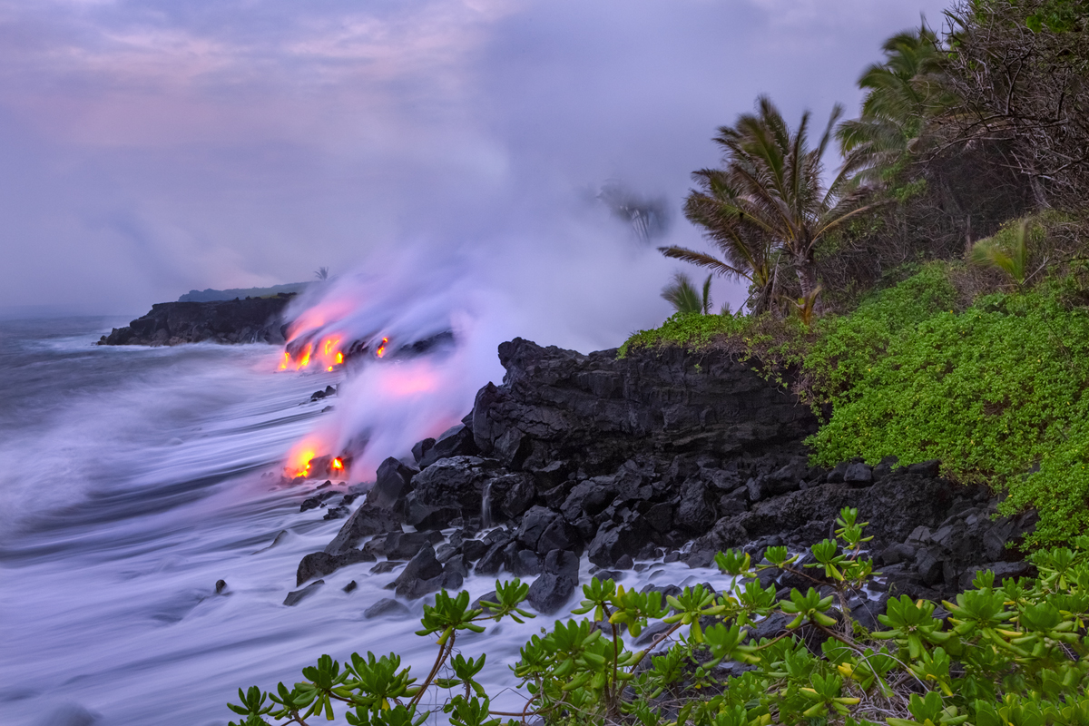 """On this morning the lava burned through a forest on the edge of the coast covering a popular black sand beach called """"Foxes Landing..."""