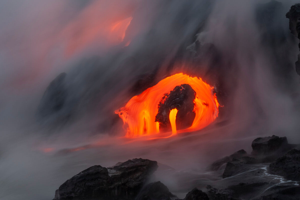 A unique formation of lava drips in the ocean as the steam and water take over the coastline.