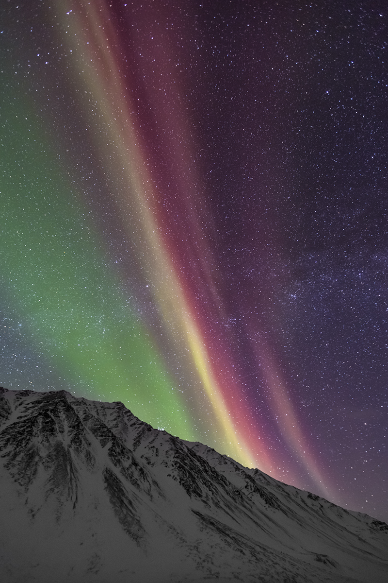 A rare display of the color red in the northern lights shows its beauty over the Brooks Mountain Range.  Solar activity is a...