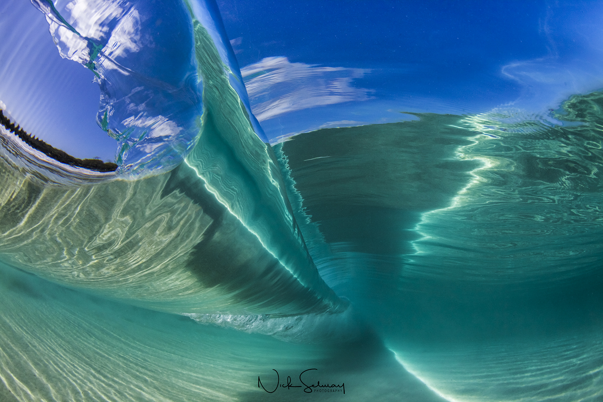 In this gorgeous image, the wave looks perfect. From the lighting to smooth water the wave looks like glass. Shop this print & a variety of wave photo prints.